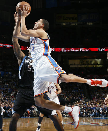 Oklahoma City's Kevin Martin (23) takes the ball to the basket against Minnesota's Dante Cunningham (33) during an NBA basketball game between the Oklahoma City Thunder and Minnesota Timberwolves at Chesapeake Energy Arena in Oklahoma City, Friday, Feb. 22, 2013. Photo by Nate Billings, The Oklahoman