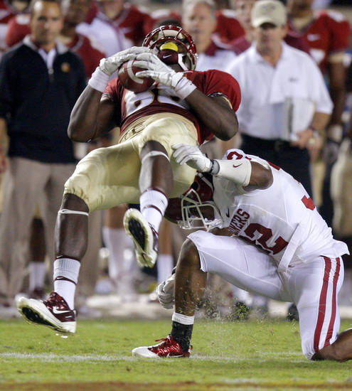 Oklahoma's Jamell Fleming (32) brings down Florida's Beau Reliford (88) during a college football game between the University of Oklahoma (OU) and Florida State (FSU) at Doak Campbell Stadium in Tallahassee, Fla., Saturday, Sept. 17, 2011. Oklahoma won 23-13. Photo by Bryan Terry, The Oklahoman