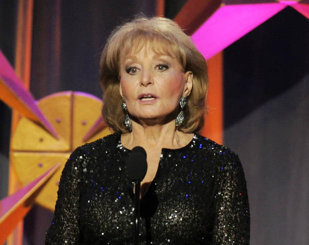 FILE - This June 23, 2012 file photo shows Barbara Walters presenting an award onstage at the 39th Annual Daytime Emmy Awards in Beverly Hills, Calif. Walters returned to �The View� on Monday, March 4, 2013. Walters was hospitalized on Jan. 19 after fainting and cutting her head at a party in Washington. The 83-year-old said she had chickenpox and a fever at the time but didn't realize it. She got a thunderous welcome from the studio audience and co-panelists Sherri Shepherd, Elisabeth Hasselbeck and Joy Behar, as well as well-wishers Regis Philbin and New York City Mayor Michael Bloomberg, who stopped by.  (Photo by Chris Pizzello/Invision/AP, file)