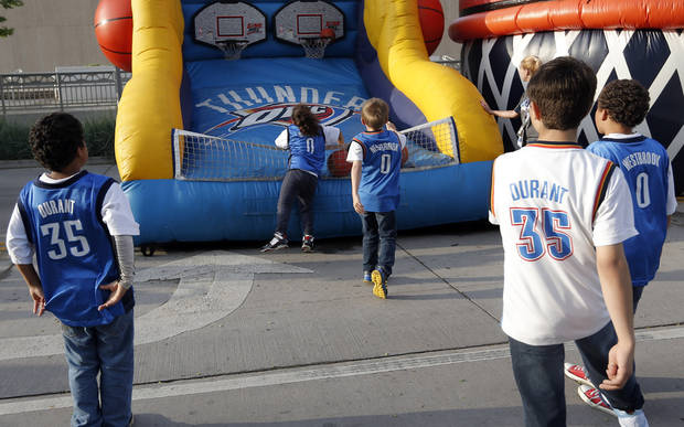 Fans play a basketball game before Game 5  in the first round of the NBA playoffs between the Oklahoma City Thunder and the Houston Rockets at Chesapeake Energy Arena in Oklahoma City, Wednesday, May 1, 2013. Photo by Sarah Phipps, The Oklahoman
