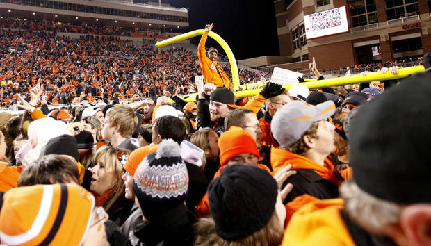 Fans celebrate following the Bedlam college football game between the Oklahoma State University Cowboys (OSU) and the University of Oklahoma Sooners (OU) at Boone Pickens Stadium in Stillwater, Okla., Saturday, Dec. 3, 2011. OSU won 44-10. Photo by Sarah Phipps, The Oklahoman