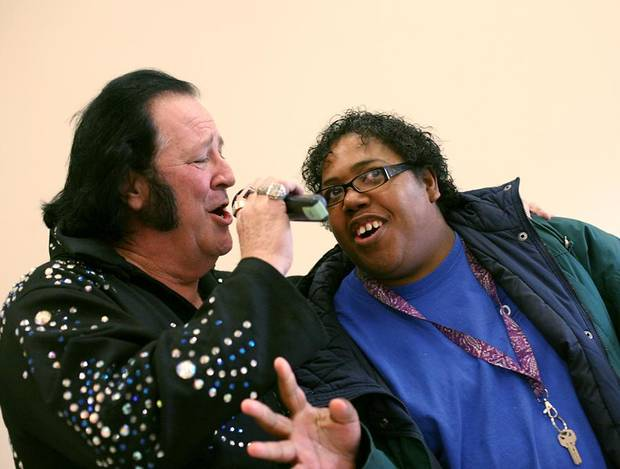 Kim Randle, a client at Oklahoma Foundation for the Disabled, dances and sings with Elvis impersonator, Mike Black, during the grand opening of the new Impact Oklahoma Recreation Center at the Oklahoma Foundation for the Disabled in Oklahoma City on Tuesday, Jan. 18, 2011. Photo by John Clanton, The Oklahoman
