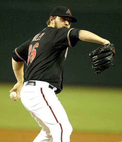 Arizona Diamondbacks starting pitcher Wade Miley  throws in the first inning during a baseball game against the Colorado Rockies on Saturday, July 6, 2013, in Phoenix. (AP Photo/Rick Scuteri)