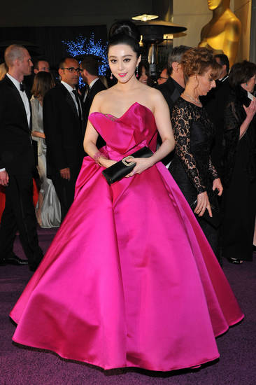 Chinese actress Bingbing Fan dares to wear color in a fuschia Marchessa ballgown at the 2013 Academy Awards. (Photo by Vince Bucci/Invision/AP) <strong>Vince Bucci</strong>