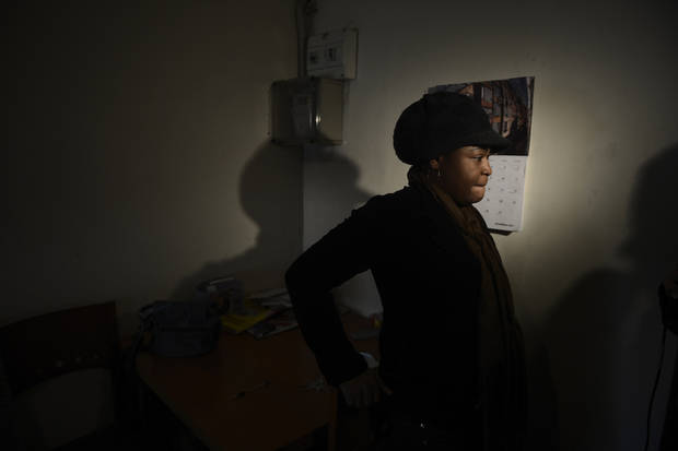 Cynthia Odigie waits her eviction in Barcelona, Spain, Thursday, Nov. 15, 2012. The Spanish government on Thursday passed a decree suspending evictions of the most vulnerable homeowners unable to pay their mortgage, a bid to ease a trend that has seen hundreds of thousands of people lose their homes because of the brutal economic crisis. The eviction was finally suspended. (AP Photo/Manu Fernandez)