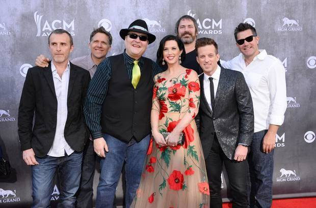 Fourth from right, Shawna Thompson and second from right, Miami, OK, native Keifer Thompson, of the musical group Thompson Square with the musical group Blues Traveler arrive at the 49th annual Academy of Country Music Awards at the MGM Grand Garden Arena on Sunday, April 6, 2014, in Las Vegas. (AP)