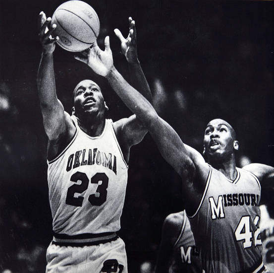 Former OU basketball player Wayman Tisdale. NORMAN, Okla., Jan. 16--LOOKS TO BLACK THE PASS -- Missouri forward Malcolm Thomas, 42, looks to break up a pass to Oklahoma center Wayman Tisdale, 23, during first half action Wednesday night in Norman,Okla. The 13th ranked Sooners led the Tigers 52-39 at the half. (AP Laserphoto by David Longstreath) 1985. Photo taken 1/16/1985, Photo published 1/17/1985 in The Daily Oklahoman. ORG XMIT: KOD