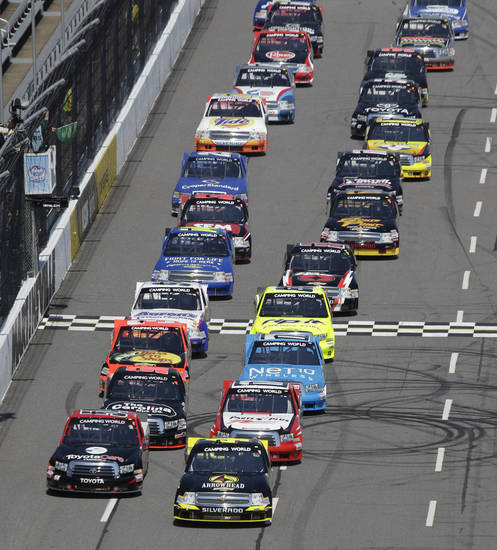 Driver Jeb Burton, front right, leads the pack at the start of the Kroger 250 NASCAR Truck series auto race at Martinsville Speedway, Saturday, April 6, 2013, in Martinsville, Va. (AP Photo/Steve Helber)