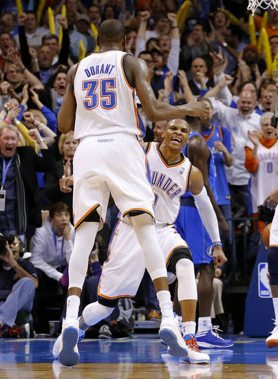 Oklahoma City's Russell Westbrook (0) and Kevin Durant (35) celebrate during an NBA basketball game between the Oklahoma City Thunder and the Dallas Mavericks at Chesapeake Energy Arena in Oklahoma City, Thursday, Dec. 27, 2012.  Oklahoma City won 111-105. Photo by Bryan Terry, The Oklahoman