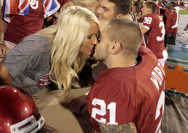 Tom Wort (21) gets a kiss from friend Alexis Hancock following the college football game between the University of Oklahoma Sooners (OU) and Florida A&M Rattlers at Gaylord Family�Oklahoma Memorial Stadium in Norman, Okla., Saturday, Sept. 8, 2012. Photo by Steve Sisney, The Oklahoman