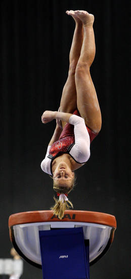 Oklahoma's Rebecca Clark competes on the vault during the Perfect 10 Challenge hosted by the Bart and Nadia Sports and Health Festival at the Cox Convention Center in Oklahoma City, Friday, Feb. 10, 2012. Photo by Bryan Terry, The Oklahoman