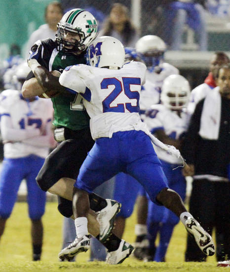 Jacob Lewis (7) of Bishop McGuinness is stopped by Sheldon Bulock (25) of Millwood after gaining yards during a high school football game between Millwood and Bishop McGuinness at Bishop McGuinness Catholic High School in Oklahoma City, Friday, Sept. 16, 2011. Photo by Nate Billings, The Oklahoman