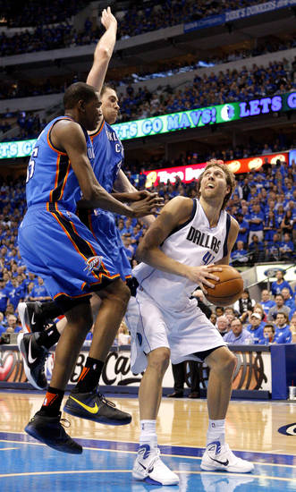 Oklahoma City's Kevin Durant (35) and Nick Collison (4) defend Dirk Nowitzki (41) of Dallas  during game 2 of the Western Conference Finals in the NBA basketball playoffs between the Dallas Mavericks and the Oklahoma City Thunder at American Airlines Center in Dallas, Thursday, May 19, 2011. Photo by Bryan Terry, The Oklahoman