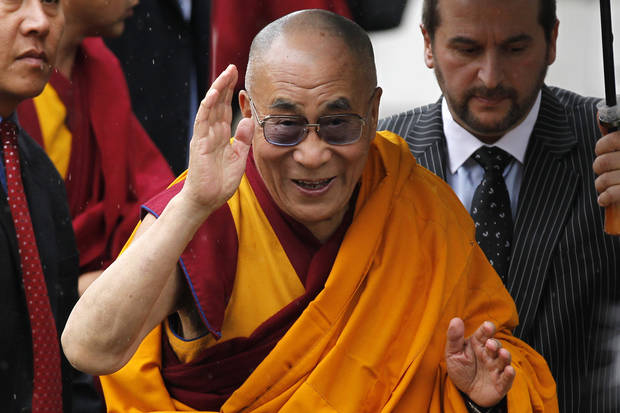 Tibetan Buddhist spiritual leader, Dalai Lama arrives at St. Paul's Cathedral in London to receive the 2012 Templeton Prize awarded to him for encouraging scientific research and harmony among religions, Monday, May 14, 2012. (AP Photo/Sang Tan)