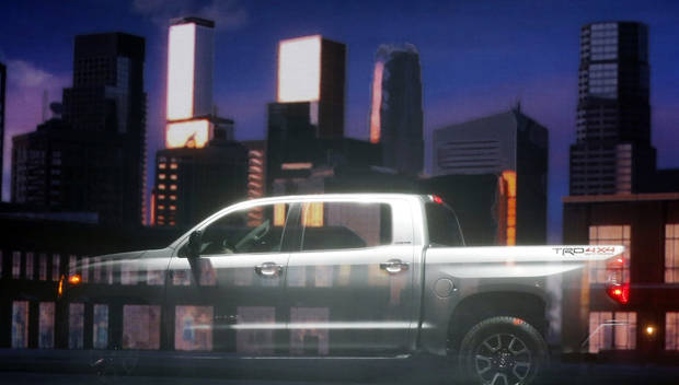 The redesigned 2014 Toyota Tundra is photographed behind a projection screen during its unveiling at the Chicago Auto Show Thursday, Feb. 7, 2013, in Chicago. (AP Photo/Charles Rex Arbogast)