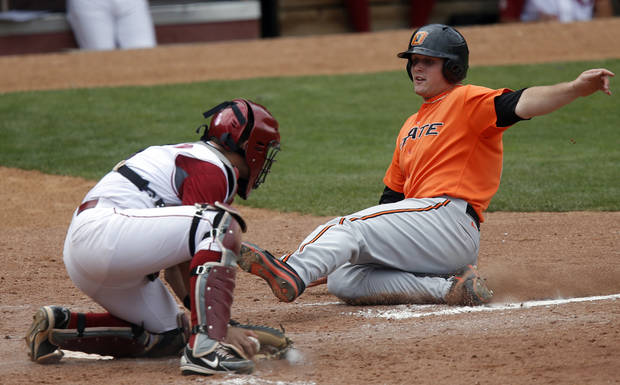 Oklahoma's Anthony Hermelyn tags out Oklahoma State's Zach Fish during the Bedlam baseball game between the University of Oklahoma and Oklahoma State University at the Chickasaw Bricktown Ballpark in Oklahoma CIty, Sunday, May 12, 2013. Photo by Sarah Phipps, The Oklahoman