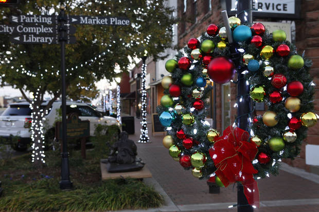 Colorful wreaths decorate light poles in downtown Edmond.