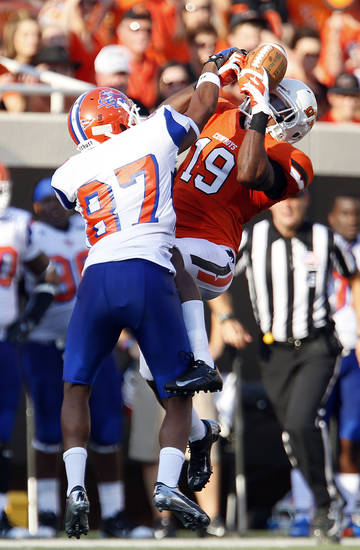 Oklahoma State's Brodrick Brown (19) breaks up a pass intended for Savannah State's Marcus Johnson (87) during a college football game between Oklahoma State University (OSU) and Savannah State University at Boone Pickens Stadium in Stillwater, Okla., Saturday, Sept. 1, 2012. Photo by Sarah Phipps, The Oklahoman