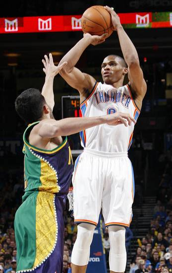 Oklaoma City&#039;s Russell Westbrook (0) shoots a jumper over New Orleans&#039; Greivis Vasquez (21) during an NBA basketball game between the Oklahoma City Thunder and the New Orleans Hornets at the Chesapeake Energy Arena in Oklahoma City, Monday, Feb. 20, 2012. Photo by Nate Billings, The Oklahoman