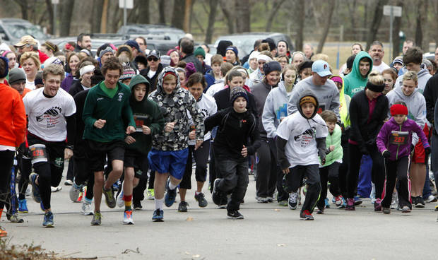 The cold, wet weather didn't keep runners and walkers away from Edmond's E.C. Hafer Park to raise money for suicide prevention. PHOTO BY PAUL HELLSTERN, THE OKLAHOMAN. <strong>PAUL HELLSTERN - THE OKLAHOMAN</strong>