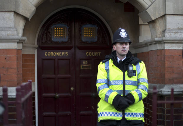 A policeman stands on duty outside Westminster Coroner's Court where the initial inquest into nurse Jacintha Saldanha's death is being opened, in London,Thursday, Dec. 13, 2012. Saldanha, the nurse who passed a hoax call into the hospital room of the pregnant Duchess of Cambridge, apparently killed herself three days later, with a coroner's officer saying Tuesday she was found hanging by the neck and a detective saying she left three notes. (AP Photo/Alastair Grant)