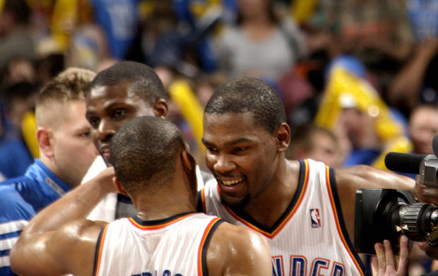 Oklahoma City's Kevin Durant (35) and Russell Westbrook (0) celebrate the Thunder's win following the NBA basketball game between the Oklahoma City Thunder and the Denver Nuggets at the Chesapeake Energy Arena, Sunday, Feb. 19, 2012. Photo by Sarah Phipps, The Oklahoman