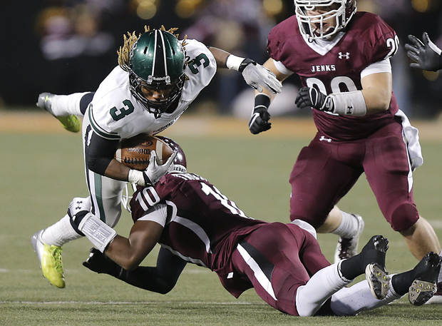 Norman North's Bryan Payne (3) is tripped up by Jenks' Steven Parker (10) during the Class 6A Oklahoma state championship football game between Norman North High School and Jenks High School at Boone Pickens Stadium on Friday, Nov. 30, 2012, in Stillwater, Okla.   Photo by Chris Landsberger, The Oklahoman