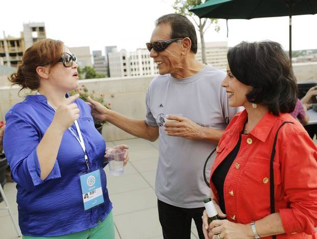Kim Haywood, Director of Proframming/Festival Director, left, visits with Honoree Wes Studi and his wife Maura Dhu Studi at the deadCENTER opening party on the rooftop of OKCMOA,Thursday June 12, 2014. Photo by Doug Hoke, The Oklahoman