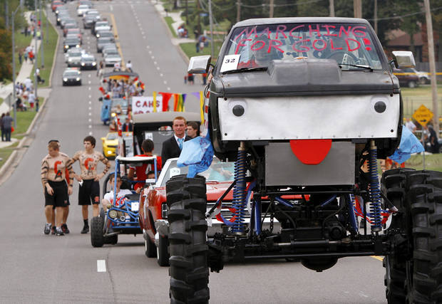 Left: Carl  Albert High School  celebrates its homecoming and 50th  birthday with a two-mile long parade on Friday.  Photo by Jim Beckel,  THE OKLAHOMAN