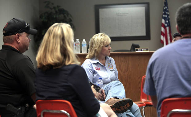 Gov. Mary Fallin visits with city officials, Sunday, Aug. 5, 2012, in Drumright, Okla., after wildfires moved through the area Saturday. Photo by Sarah Phipps, The Oklahoman