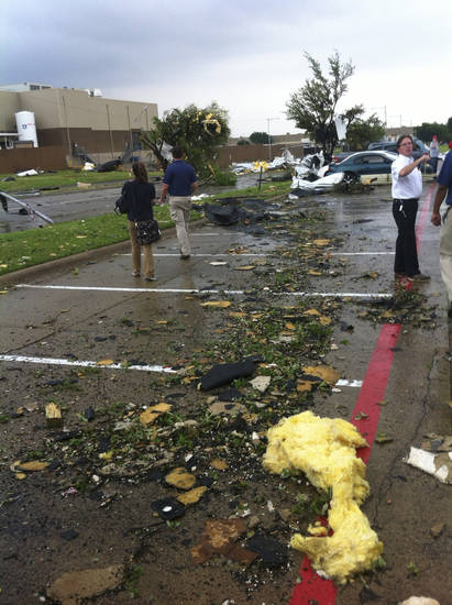 Debris is scattered on the ground after a storm passed through in Arlington, Texas on Tuesday, April 3, 2012.  Tornadoes tore through the Dallas area on Tuesday, tearing roofs off homes, tossing trucks into the air and leaving flattened tractor trailers strewn along highways and parking lots. The National Weather Service confirmed at least two separate &quot;large and extremely dangerous&quot; tornadoes in the Dallas-Fort Worth area. Several other developing twisters were reported as a band of violent storms moved north through the metropolitan area.   (AP Photo/The Dallas Morning News, Nathan Hunsinger )  MANDATORY CREDIT; MAGS OUT; TV OUT; INTERNET OUT; AP MEMBERS ONLY  ORG XMIT: TXDAM103