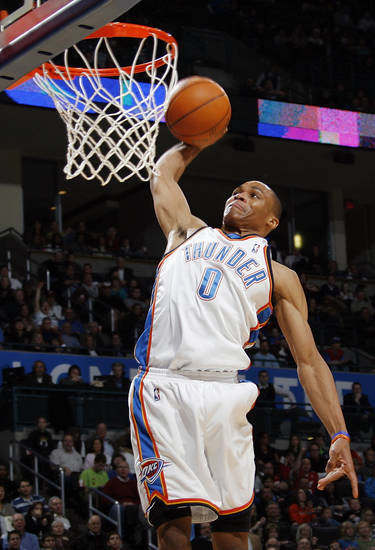 Oklahoma City's Russell Westbrook (0) dunks the ball during the NBA basketball game between the Atlanta Hawks and the Oklahoma City Thunder at the Ford Center in Oklahoma City, Tuesday, February 2, 2010. The Thunder won, 106-99. Photo by Nate Billings, The Oklahoman