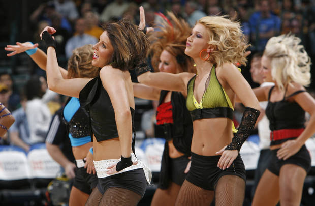 The Thunder Girls perform during the NBA basketball game between the Chicago Bulls and the Oklahoma City Thunder at the Ford Center in Oklahoma City, Wednesday, March 18, 2009. PHOTO BY NATE BILLINGS, THE OKLAHOMAN