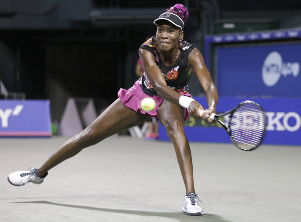 Venus Williams of the U.S. returns a shot against Eugenie Bouchard of Canada during their quarterfinal match of the Pan Pacific Open tennis tournament in Tokyo, Thursday, Sept. 26, 2013. (AP Photo/Shizuo Kambayashi)