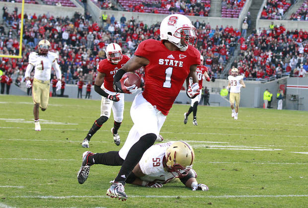 North Carolina State cornerback David Amerson (1) beats Boston College center Andy Gallik (59) as he takes an interception in for a touchdown during the first half of an NCAA college football game Saturday, Nov. 24, 2012, in Raleigh, N.C. (AP Photo/The News & Observer, Ethan Hyman) MANDATORY CREDIT