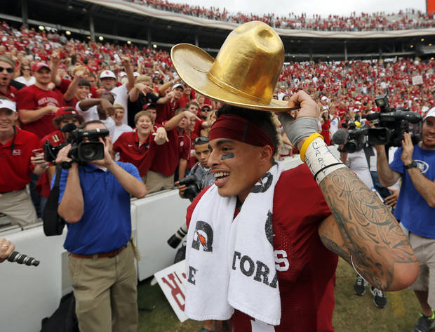 OU's Kenny Stills (4) celebrates with the Golden Hat trophy after the Red River Rivalry college football game between the University of Oklahoma (OU) and the University of Texas (UT) at the Cotton Bowl in Dallas, Saturday, Oct. 13, 2012. OU won, 63-21. Photo by Nate Billings, The Oklahoman