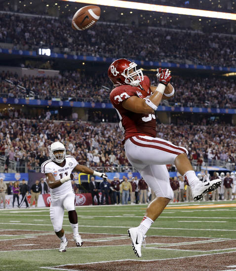 Oklahoma's Trey Millard (33) misses the ball in the end zone during the Cotton Bowl college football game between the University of Oklahoma (OU)and Texas A&M University at Cowboys Stadium in Arlington, Texas, Friday, Jan. 4, 2013. Oklahoma lost 41-13. Photo by Bryan Terry, The Oklahoman