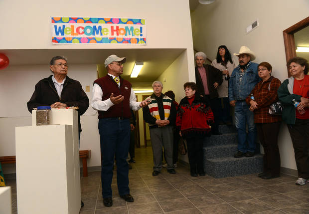 FILE - In this Saturday, Nov. 3, 2012 file photo, Henry Anderson, left, and James Parker Shield welcome people to the new Little Shell Chippewa Cree Visitor Center in Montana. Montana's Little Shell tribe appeared poised to fade from history in recent years after it was denied federal government recognition, lost its financial support from the state and saw its elected leadership splinter. But the past year has brought a sharp turnaround for the 4,500-member landless tribe that long has existed on society's fringe. Tribal enrollment is on the rise. Government grant money is flowing again, and the Little Shell cultural and visitor center opened this month in Great Falls. (AP Photo/The Great Falls Tribune, Rion Sanders) NO SALES