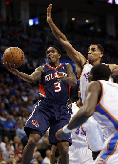Atlanta Hawk's Louis Williams (3) shoots past Oklahoma City Thunder's Thabo Sefolosha (2) as the Atlanta Hawks defeat the Oklahoma City Thunder 104-95 in NBA basketball at the Chesapeake Energy Arena in Oklahoma City, on Sunday, Nov. 4, 2012.  Photo by Steve Sisney, The Oklahoman
