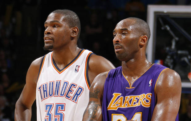 L.A. LAKERS: Oklahoma City's Kevin Durant (35) stands next to Los Angeles' Kobe Bryant (24) during an NBA basketball game between the Oklahoma City Thunder and the Los Angeles Lakers at Chesapeake Energy Arena in Oklahoma City, Thursday, Feb. 23, 2012. Photo by Bryan Terry, The Oklahoman