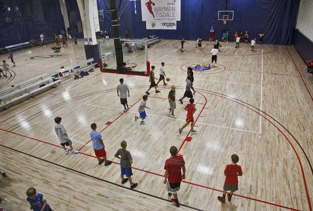 Campers take their game to the court during Los Angeles Clippers Blake Griffin's basketball camp held at the Santa Fe Family Life Center on Wednesday, Aug. 2, 2011, in Oklahoma City, Okla. Photo by Chris Landsberger, The Oklahoman