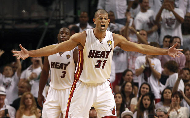 Miami Heat's Shane Battier yells as he prepares to defend against the Oklahoma City Thunder during the second quarter of Game 3 of the NBA Finals basketball series, Sunday, June 17, 2012, in Miami. (AP Photo/The Miami Herald, Charles Trainor Jr.)  MAGS OUT ORG XMIT: FLMIH205