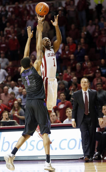 Oklahoma's Sam Grooms (1) fires a last-second shot over Kansas State's Shane Southwell (1) in the second half during an NCAA men's basketball game between the University of Oklahoma (OU) and Kansas State at the Lloyd Noble Center in Norman, Okla., Saturday, Feb. 2, 2013. Grooms missed the shot, and Kansas State won, 52-50. Photo by Nate Billings, The Oklahoman