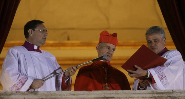 Cardinal Jean-Louis Tauran, center, announces the newly elected pope from the central balcony of St. Peter's Basilica at the Vatican, Wednesday, March 13, 2013. Argentine Cardinal Jorge Bergoglio has been elected pope, the first pontiff from Americas. (AP Photo/Gregorio Borgia) ORG XMIT: VAT128