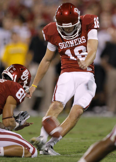 Oklahoma's Michael Hunnicutt (18) kicks an extra point during the college football game between the University of Oklahoma Sooners (OU) and the University of Missouri Tigers (MU) at the Gaylord Family-Memorial Stadium on Saturday, Sept. 24, 2011, in Norman, Okla. Photo by Bryan Terry, The Oklahoman