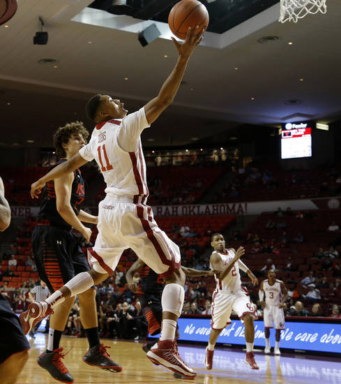 Oklahoma's Isaiah Cousins (11) goes past Texas Tech's Dusty Hannahs (2) during an NCAA college basketball game between the University of Oklahoma and Texas Tech University at Lloyd Noble Center in Norman, Okla., Wednesday, Jan. 16, 2013. Photo by Bryan Terry, The Oklahoman