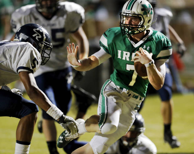 McGuinness&#039; quarterback Jacob Lewis keeps the ball as the El Reno Indians play the Bishop McGuinness Fighting Irish in high school football on Friday, Sept. 21, 2012 in Oklahoma City, Okla.  Photo by Steve Sisney, The Oklahoman