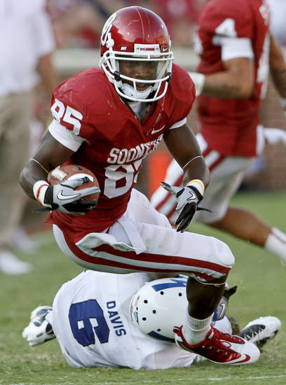 OU's Ryan Broyles is brought down by Jon Davis of Air Force during the second half of the college football game between the University of Oklahoma Sooners (OU) and Air Force (AF) at the Gaylord Family-Oklahoma Memorial Stadium on Saturday, Sept. 18, 2010, in Norman, Okla.   Photo by Bryan Terry, The Oklahoman