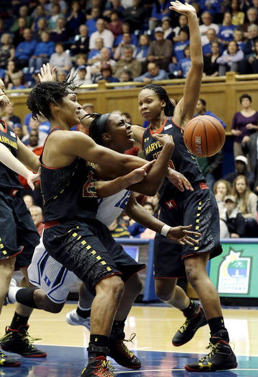 Duke's Chelsea Gray, center, drives to the basket against Maryland's Alyssa Thomas, left, and Alicia DeVaughn during the first half of an NCAA college basketball game in Durham, N.C., Monday, Feb. 11, 2013. (AP Photo/Gerry Broome)