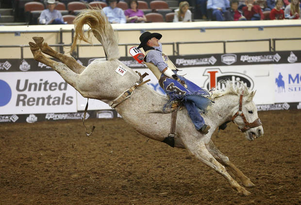Chase Erickson of Helena, Mont., rides in the bareback competition during the National Circuit Finals Rodeo at the State Fair Arena, Saturday, April 6, 2013. Photo by Bryan Terry, The Oklahoman